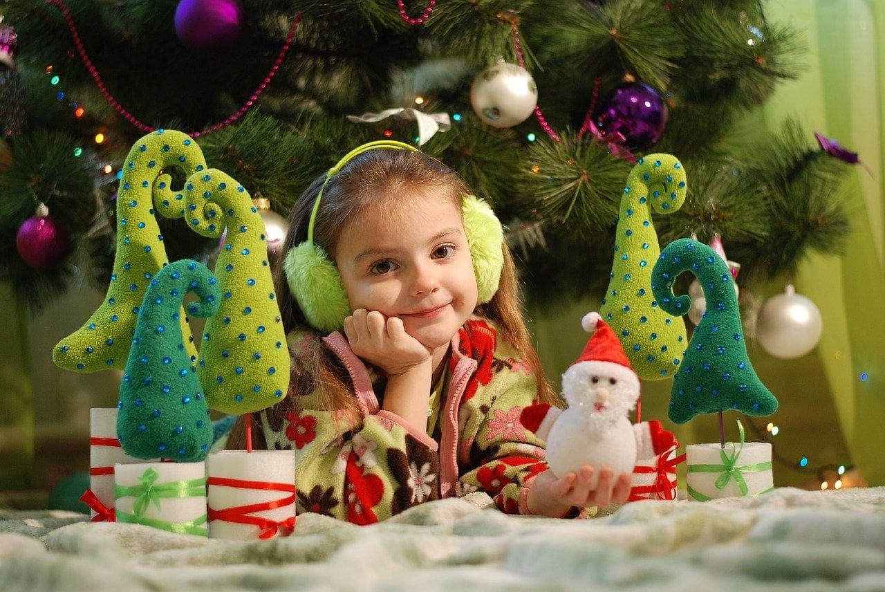 Girl holding personalized Christmas Ornaments Holiday Traditions Myornament